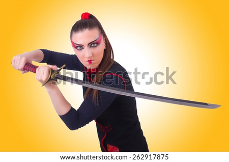 Woman in japanese martial art concept - stock photo
