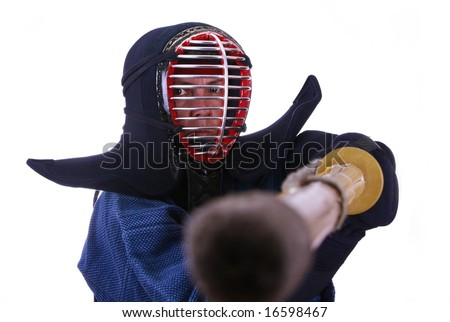 Woman in kendo (japanese fencing) helmet prepared to fight.