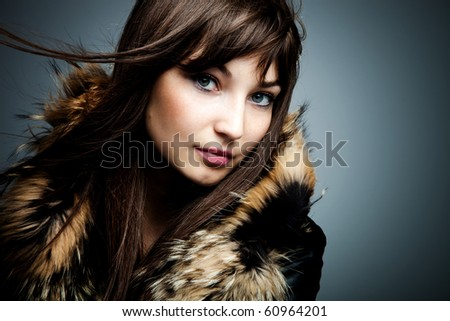 woman in leather jacket with fur portrait studio shot - stock photo