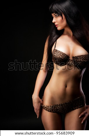 woman in leopard linergie over dark - stock photo