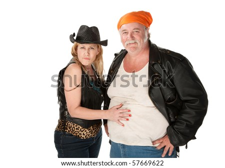 Woman in leopard skin cowgirl outfit flirting with big bellied man - stock photo
