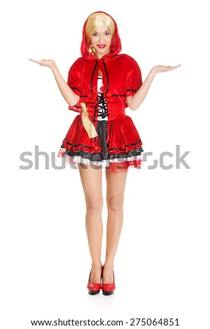 Woman in Little Red Riding Hood costume with open hands. - stock photo