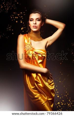 woman in long yellow dress - stock photo