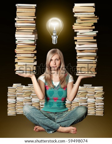 woman in lotus pose with many books in her hands and bulb - stock photo