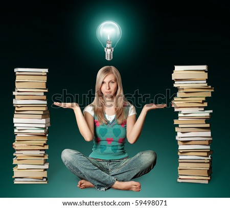 woman in lotus pose with many books near and bulb - stock photo