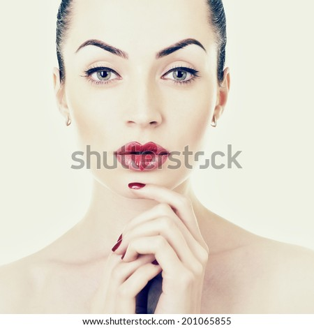 Woman in love. Beautiful girl with creative makeup with heart on her lips. Toned. - stock photo