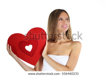 woman in love with heart in hand