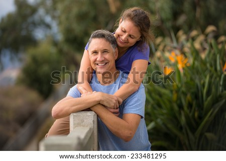 Woman in love with her husband - stock photo
