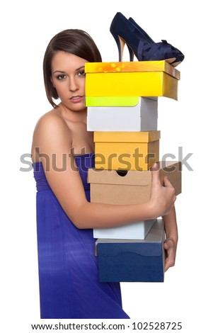 Woman in love with her shoe collection - stock photo