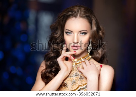 Woman in lux dress crown, queen princess lights party background Luxury girl Long shiny healthy volume hair Waves Curls Updo Hairstyle. Salon Fashion model luxurious vintage interior Jewelry Earrings - stock photo