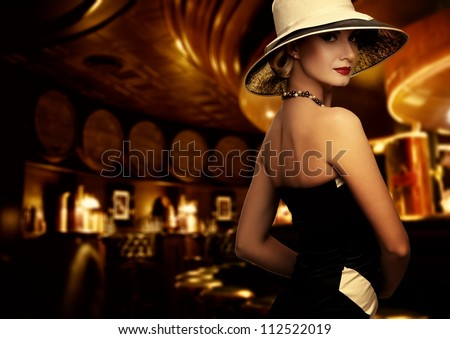 Woman in luxury club interior - stock photo