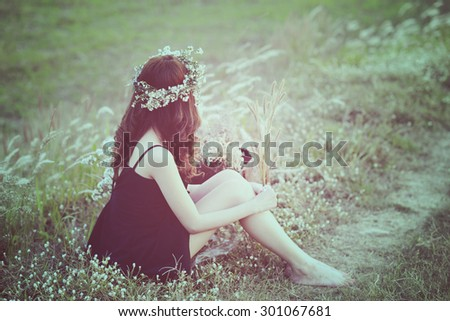 Woman in meadow. travel and sunset in vintage style  - stock photo