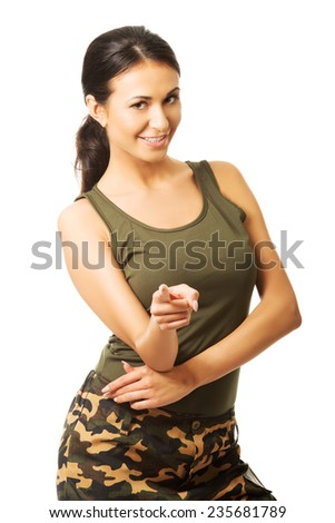 Woman in military clothes pointing on you. - stock photo