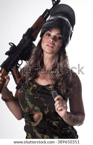 Woman in military uniform with a gun