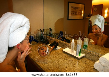 Woman in Mirror at Health Club - stock photo