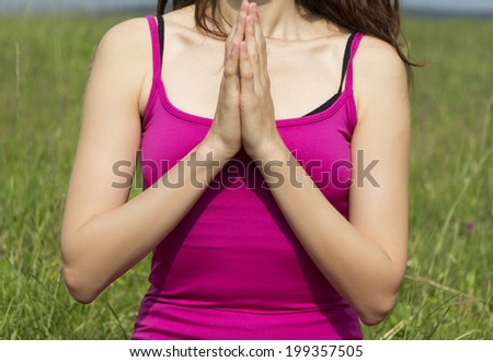 Woman in namaste pose in meditation. - stock photo