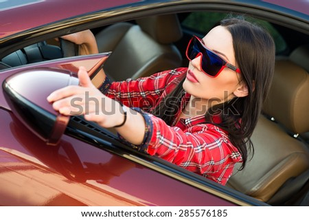 Woman in new car. Learner driver student driving car. Driver license exam - stock photo