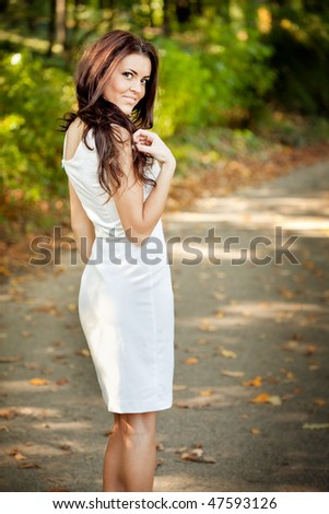 Woman in nice sexy elegant dress outdoor - stock photo