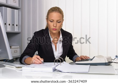 woman in office with abacus - stock photo