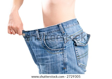 woman in old jeans after diet - stock photo