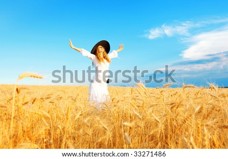 woman in open field in summer - stock photo