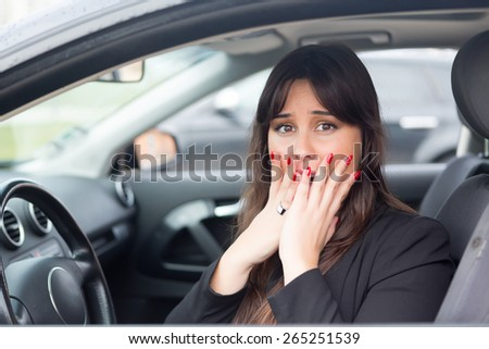 Woman in panic after having a car crash - stock photo