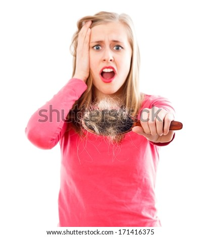 Woman in panic of her hair loss disease. - stock photo