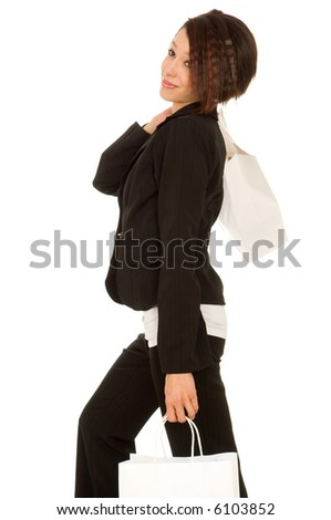 Woman in pants suit shopping with one page slung over her shoulder and another in her left hand.