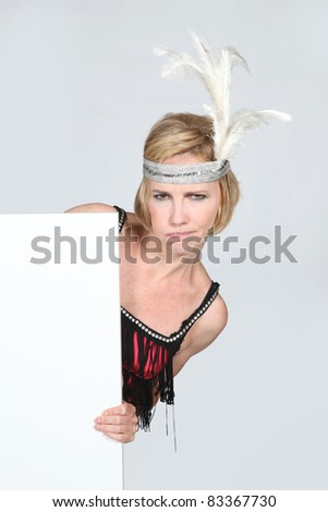 Woman in party dress holding marketing board - stock photo