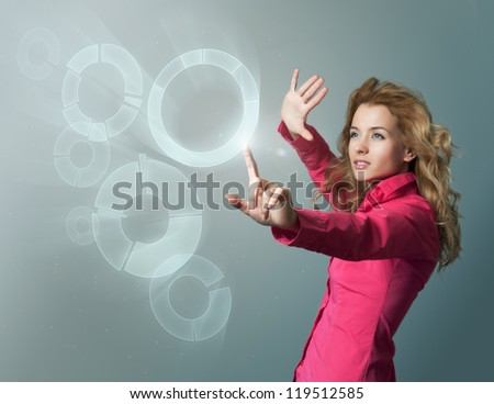 Woman in Pink Blouse Using Virtual Interface - stock photo