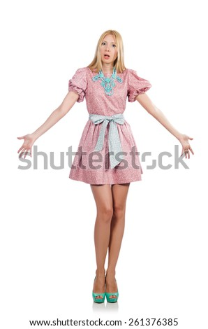 Woman in pink doll dress isolated on white - stock photo