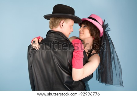 Woman in pink hat   and a man in black hat