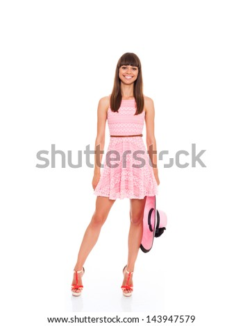woman in pink summer dress, hat and high heel shoes, young fashion model girl smile full length portrait isolated over white background - stock photo