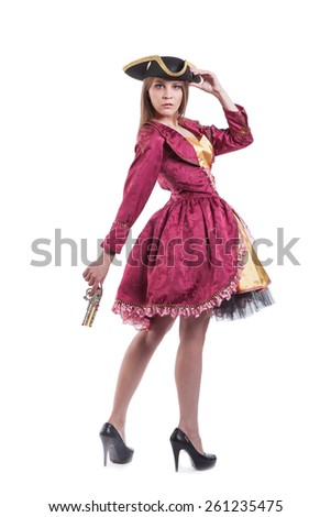 Woman in pirate carnival costume with pistol . Isolated on white - stock photo