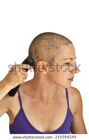 Woman in purple bodice shaving herself bald with clipper, isolated on white. Vertical composition.