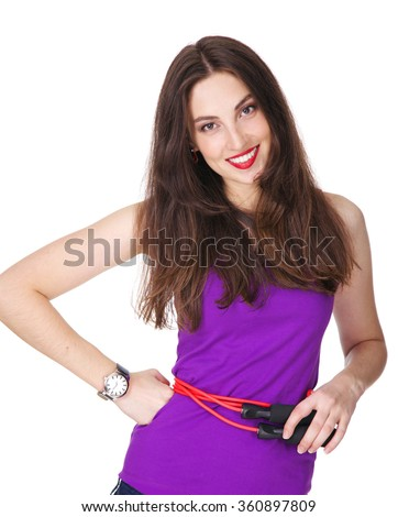 Woman in purple tank top happy smiling and holding a pink sport cord around her waist. Fit and athletic Caucasian brunette girl posing on white background. - stock photo