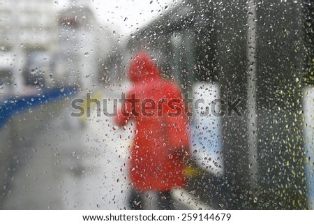 Woman in Raincoat in rainy day - stock photo