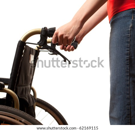 woman in red blouse and jeans with wheelchair