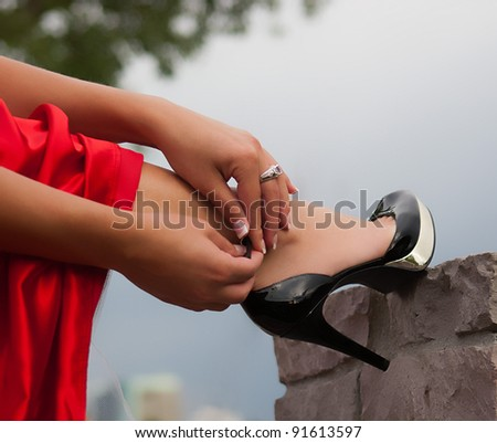 Woman in red buckling shoe - stock photo