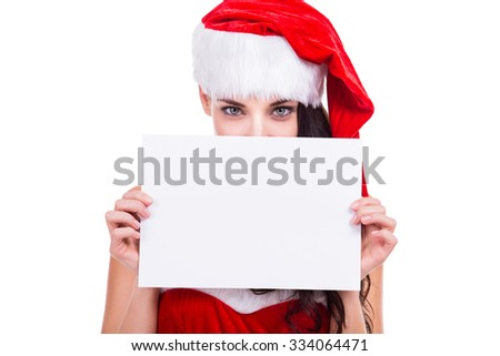 Woman in red christmas dress and hat holding a blank billboard, white background, copyspace, isolated.