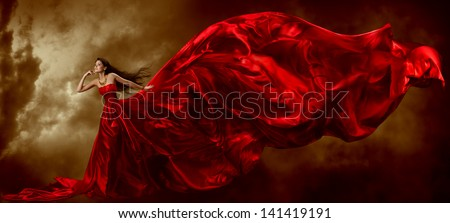 woman in red dress, beautiful waving flying fabric, artistic cloth over sky background - stock photo