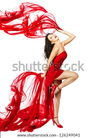 Woman  in red dress dancing with fabric flying on a wind flow. White Isolated - stock photo