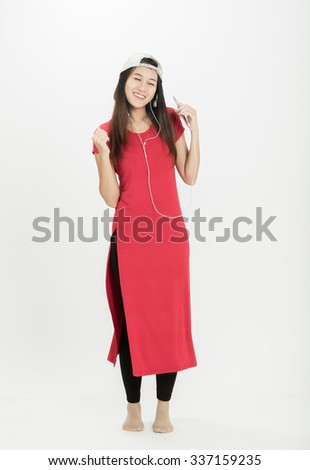 Woman in red dress dancing with happy. On a white background
