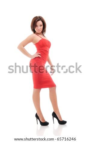 Woman in red dress. Isolated over white. - stock photo