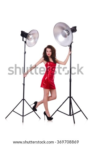 Woman in red dress posing in the studio - stock photo