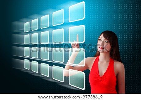 Woman in red dress touch the screen - stock photo