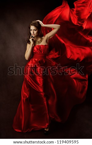 Woman in Red Dress with Flying Fabric, Gown Cloth flowing fluttering on Wind - stock photo