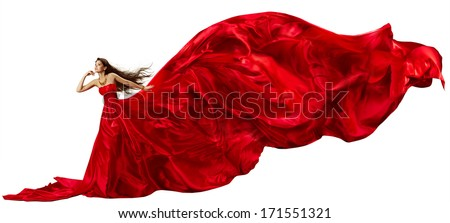 Woman in red  dress with flying fabric waving beautiful over white background - stock photo