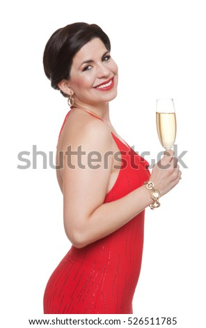 Woman in red dress with glass of sparkling wine, white background.