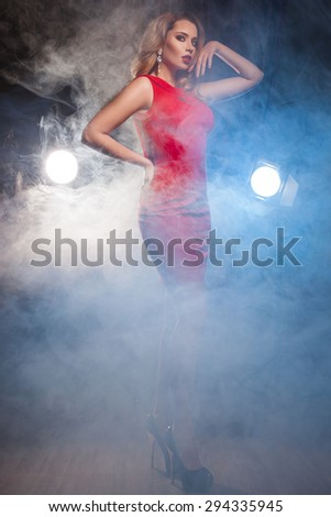 woman in red dress with light - stock photo